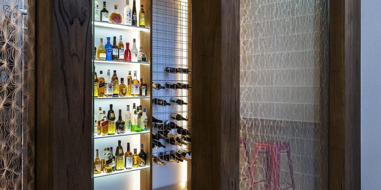 DecorDesign. Wine cellar glass screen in Merletto pattern 3 qtr shot