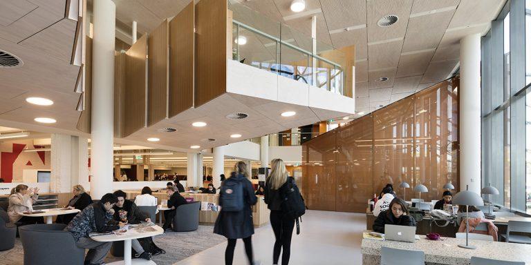 SEFAR mesh laminated glass custom printed orange. Monash University Caulfield library by John Wardle Architects